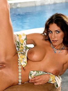 Sexy Brunette Shows Off Her Pink Poolside