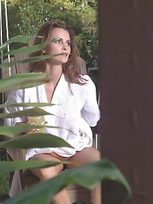 Busty Rebecca slurping a large cock in the backyard