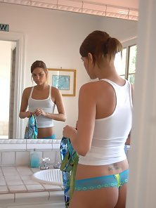 Sexy teen is checking out her hot body in the mirror