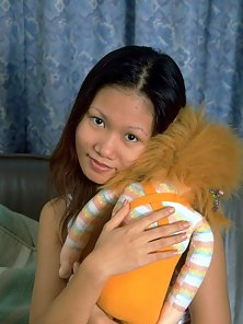 Tiny tit Asian spreads her puffy brown pussy lips