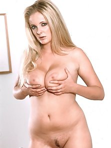 Blonde strips naked and plays with a toy showing off her giant tits