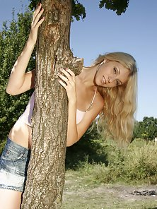 Tall blonde gets naked in her garden