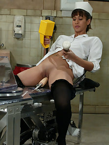 Naughty nurse examines the machines in the sex clinic.
