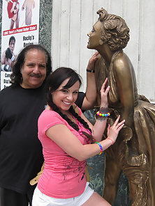 Young slut jumps on Ron Jeremy's fat dick and drains him