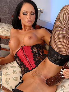 Huge titted blackhaired babe posing and dildoing