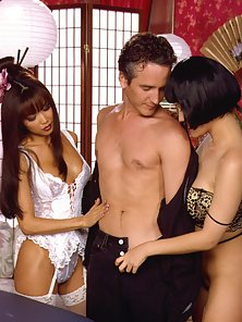 Two hot asian babes sit on a lucky guys face and dick