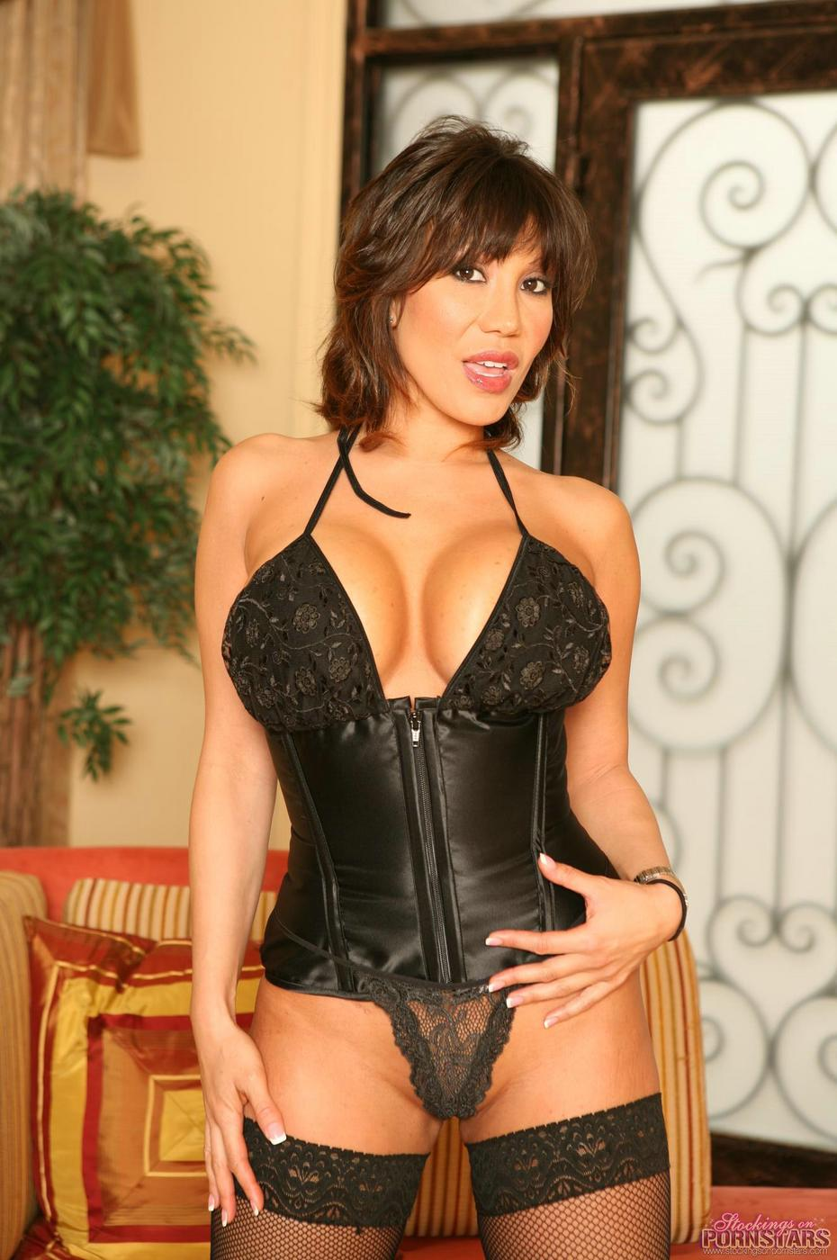 ava devine busting out of her corset and fishnet stockings - mobile