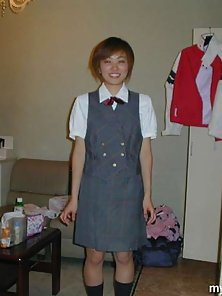 Cute japanese amateur coed in uniform strips and sucks a cock hard