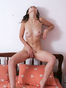 Luba lets her long hair flow as she plays with her body nice and naked on the bed