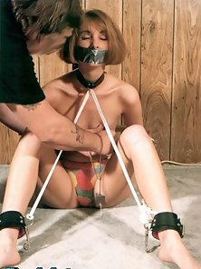 Slender amateur tied up flogged and hung upside down