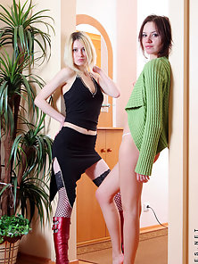 Sexy euro teens have some fun in a hallway one naked and one in fishnets and leather boots
