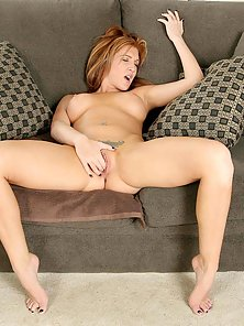 Fiery red headed cougar stuffs her pussy with her panties and then tastes them afterwards
