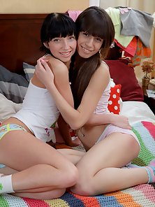 Cute brunette lesbians fucking each others pussy with dildos