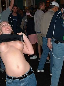 Horny sluts showing their tits at a wild party