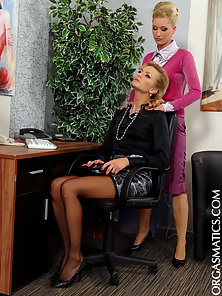 Horny clothed secretaries playing