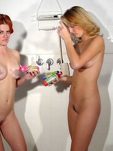 Two sweetie lesbians painting their sexy bodies