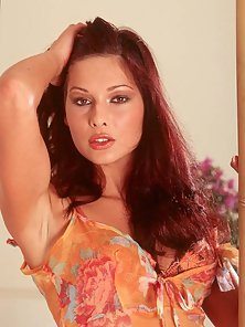 Evelyn Lory strips off her bra and thongs