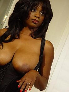 Big tit ebony babe in leather and stockings