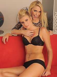 Two cute young blondes licking pussy on the couch