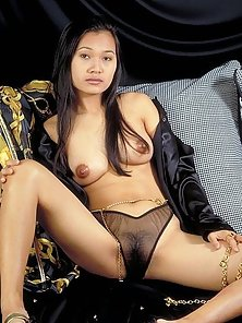 Perky titted Asian Ling showing her hairy pussy