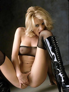 Beautiful Nicolete in fishnet stockings fingering and toying