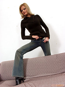Her jeans and black boots really show off her slim sexy legs