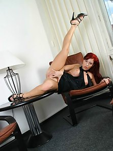 Redhead with natural juggs plays with her pussy