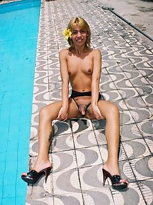 Tranny nails a tight ass by the swimming pool