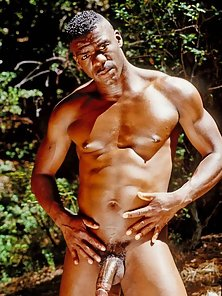 Horny black stud outside showin off his six pack