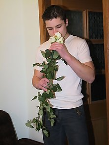 Hunky dude holding a white fragrant rose and get naked