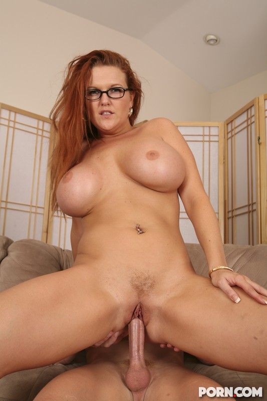 Busty redhead riding cock