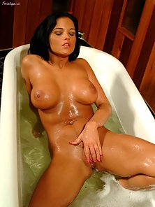 Lanny Barby wets her big tits taking a bath