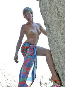Pretty Emily loves sun and nudeness, so she takes off her wear and wiggles her seductive naked body.