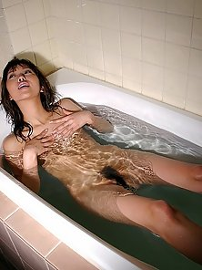 Hot and horny Asian slut takes a bath and shows close-ups of her washing that hairy pussy