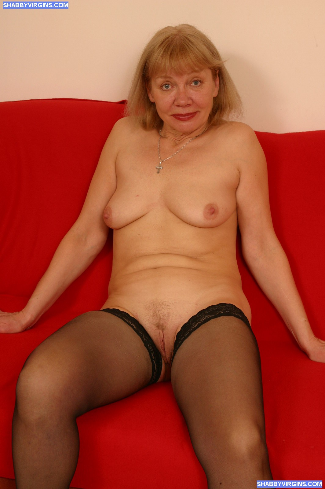 ... Wrinkled blonde shows off and toys her wet pussy ...