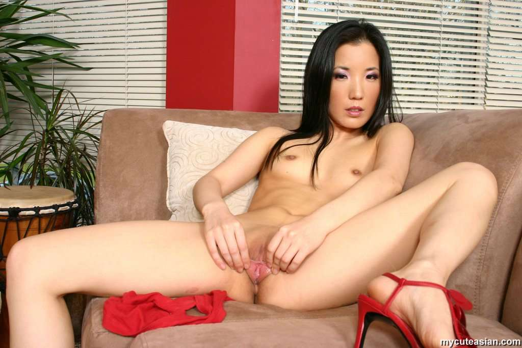 asian tease sex - ... Asian Almond Tease plays with huge blue dildo ...