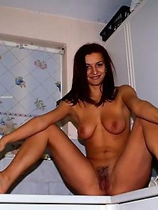 Busty wife Marie showing her divine tits in the kitchen