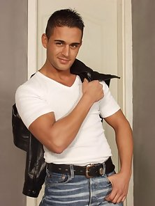He strips off his tight jeans and tight white T-shirt exposing his masculine cut body.