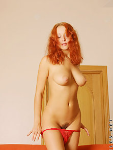 Just a busty redhead all naked and basically perfect having fun in a photoshoot