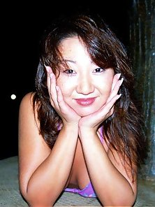 My horny busty asian wife posing nude outdoor