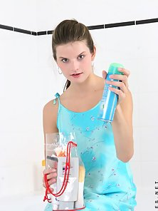 Hottie in the shower watch carolina get all nice and wet spraying the water all over her tiny boobie