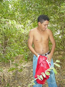 Horny latino guy stripping in the jungle
