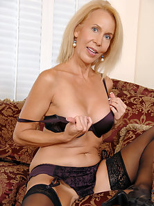 Sensual milf stunner fondles her juicy tits on the sofa with a rabbit toy in her hairy pussy