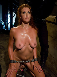 Hot Redheaded slave girl trained to serve sadistic Masters