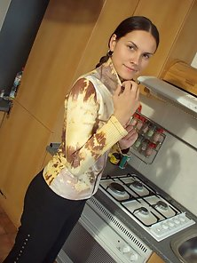 Teen babe is so horny she fingers herself on the kitchen counter.