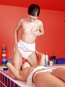 Horny lesbians madly kissing in the kitchen craving for pleasure