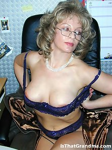 Hot blonde grandma getting naughty in the office