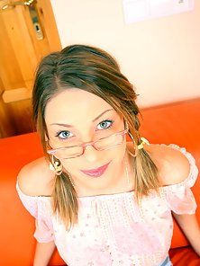 Teenie with glasses receives cum on her cute young face