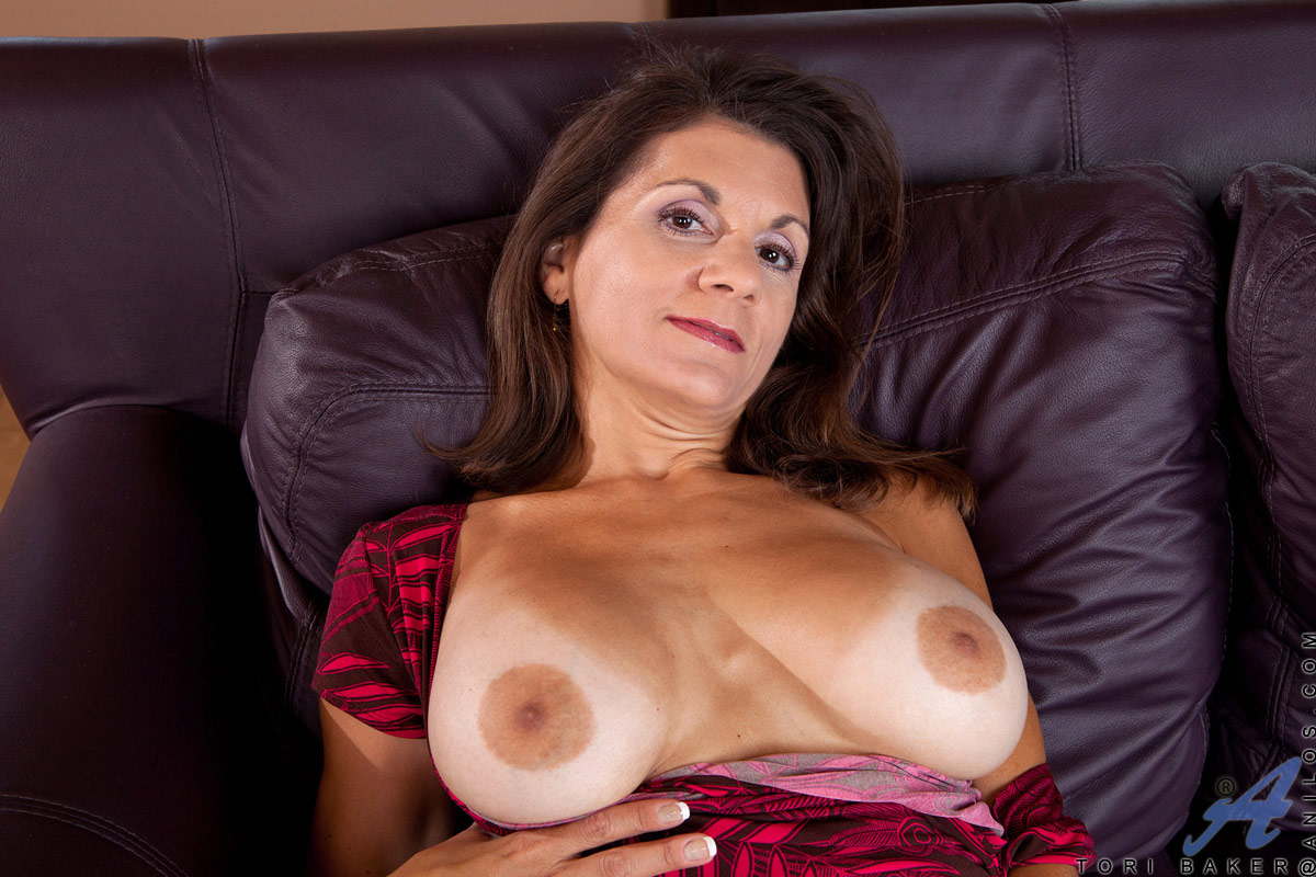 ... Classy Anilos lady pleasures her mature pussy with a purple vibrator ...
