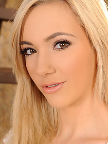 Hot blonde young babe Sophia Knight stripteasing